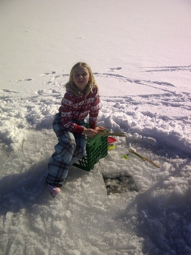 Catching more fish than her brothers at her Winter Cottage Vacation